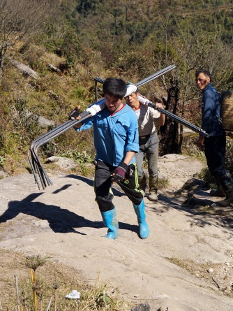 Porters bringing up reinforcing iron. Photo courtesy of Jessica @ Words and Wilds.