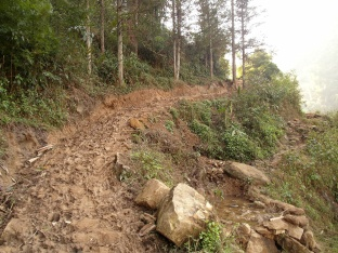 The improved path from one village into the hills, already thick with mud.